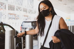 Woman traveling with mask